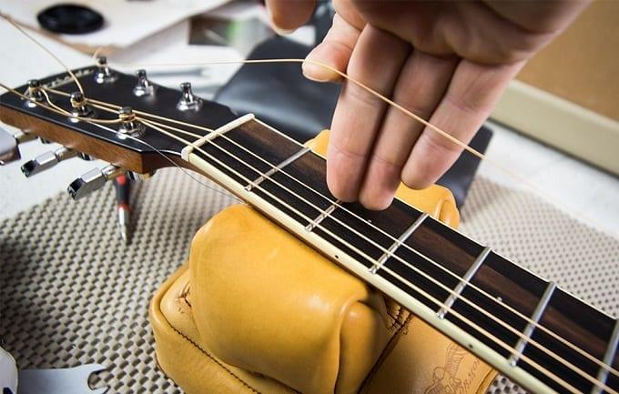 Holding Guitar String